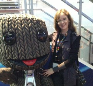 LittleBigPlanet game composer Winifred Phillips in a photo with the game's star, Sackboy.