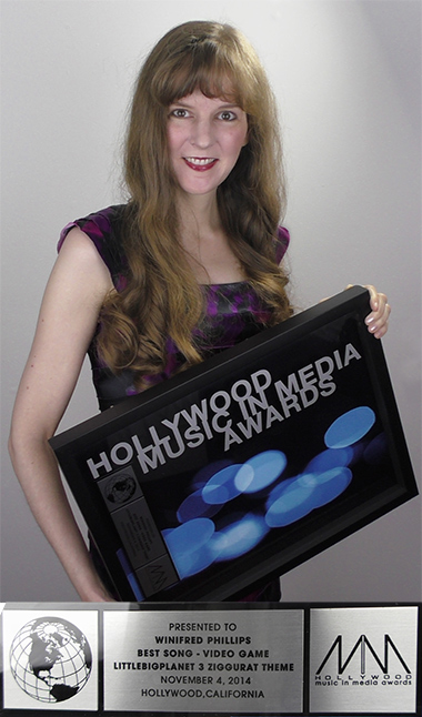 Here I am, holding the Hollywood Music in Media Award I won for