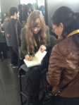 Signing a book for Rena!