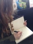 Signing a book for Ashley