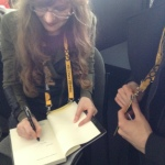 Signing a book for Kevin