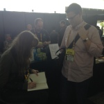 Signing a book for Zachary