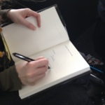 Signing a book for Joshua