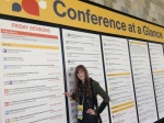 """On Friday, the big """"Conference At A Glance"""" display went up for that day's sessions, and I had to get a photo showing my morning talk, """"LittleBigPlanet 3 and Beyond: Taking Your Score to Vertical Extremes"""""""