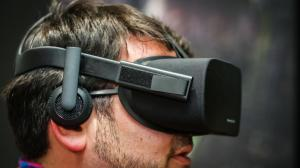 The Oculus Rift, shipping with detachable headphones.