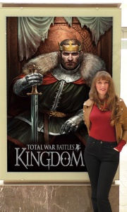 Photo of composer Winifred Phillips with Total War Battles: Kingdom display