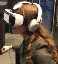 Video game composer Winifred Phillips demonstrating the Samsung Gear VR headset during the AES convention in NYC.