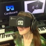 Game composer Winifred Phillips tries out the VR experience of Google Cardboard (pictured here in her music production studio).
