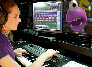 video game music composer Winifred Phillips, working in her studio on the music of The Maw video game.