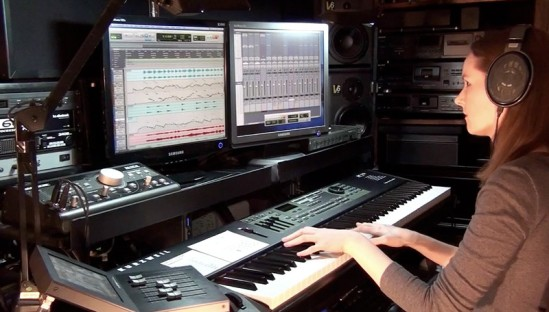 Composer Winifred Phillips working in her production studio on music for the Ultimate Trailers album (West One Music).