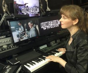 Composer Winifred Phillips, working on music for Homefront: The Revolution in her music studio.