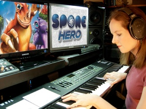 A photo of video game composer Winifred Phillips, working in her studio on the music of the Spore Hero video game.
