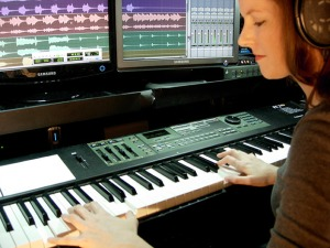 Video game composer Winifred Phillips, working in her music studio.