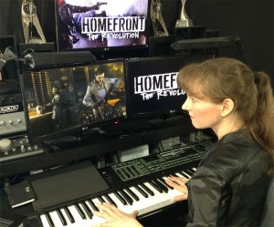 Video game composer Winifred Phillips, composing music for the triple-A first person shooter HOMEFRONT: THE REVOLUTION in her music studio.