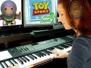 Video game music composer Winifred Phillips, shown working on the music of LittleBigPlanet 2 Toy Story.