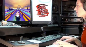 Photo of video game composer Winifred Phillips working in her music production studio on the music of the Speed Racer video game.