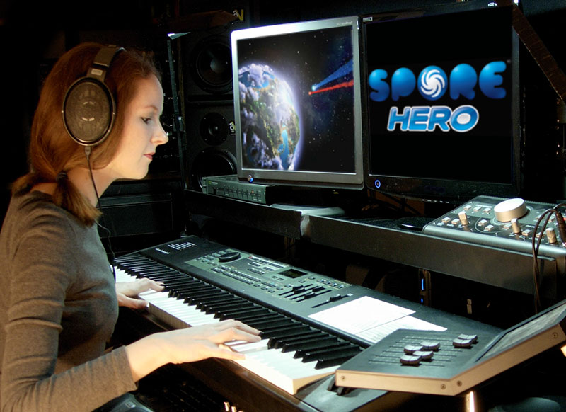 Photo of composer Winifred Phillips working on the video game music of Spore Hero from Electronic Arts.