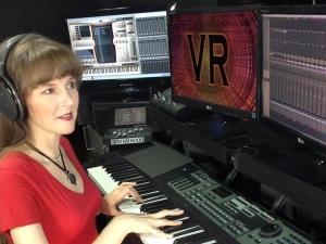 "Photo of game composer Winifred Phillips in her music production studio, from the article ""Video Game Music Composer: Music and Sound in VR Headphones (Part Two)"""