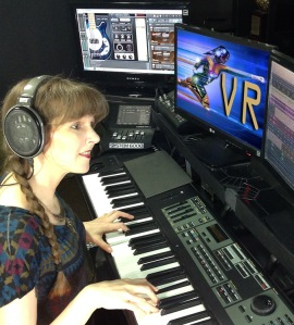 "Photo of game composer Winifred Phillips in her music production studio, from the article ""Video Game Music Composer: Music and Sound in VR Headphones (Part One)"""