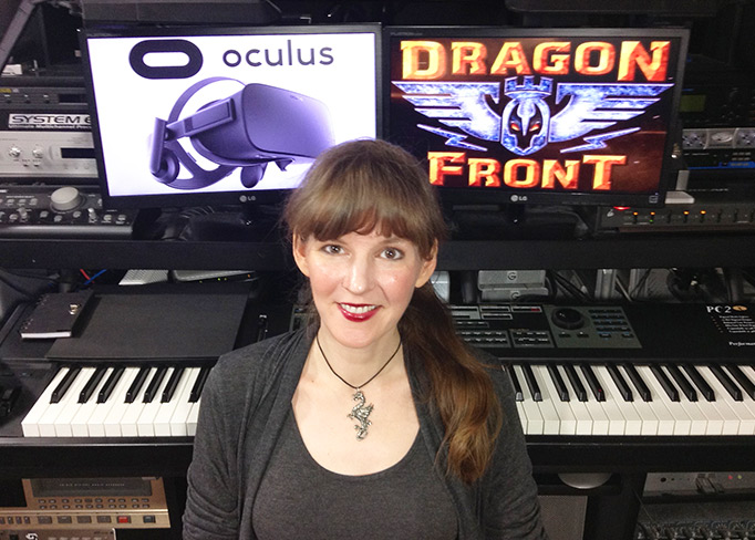 Video game composer Winifred Phillips, pictured in her music studio working on the original score for the Dragon Front virtual reality game.