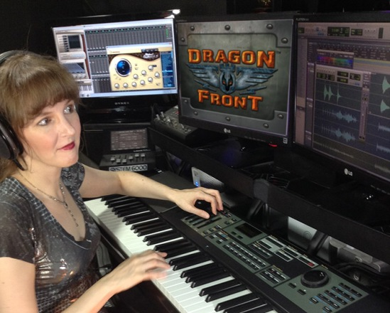 Pictured: Winifred Phillips (video game music composer) in her studio working on the music of the Dragon Front virtual reality game.