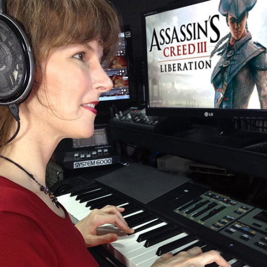 Winifred Phillips, composer of video game music, shown in her studio working on the music of the Assassin's Creed Liberation video game.