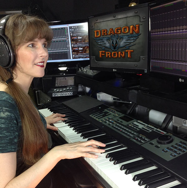 Video game composer Winifred Phillips, pictured in her music production studio working on the music of the Dragon Front virtual reality game for Oculus Rift and Samsung Gear VR.