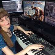 Video game music composer Winifred Phillips working in her studio on the music of the God of War video game.