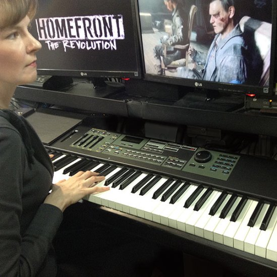 Winifred Phillips (video game composer), working in her studio on the music of the Homefront: The Revolution video game.