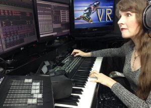 Famous video game composer Winifred Phillips works in her music production studio.