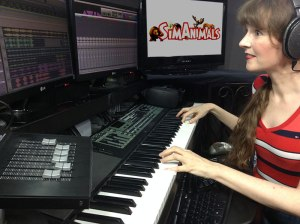 Video game music composer Winifred Phillips, pictured in her music production studio working on the music of the SimAnimals video game.