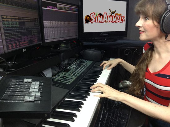 Photo of video game composer Winifred Phillips, working in her music production studio on the music of the SimAnimals video game.