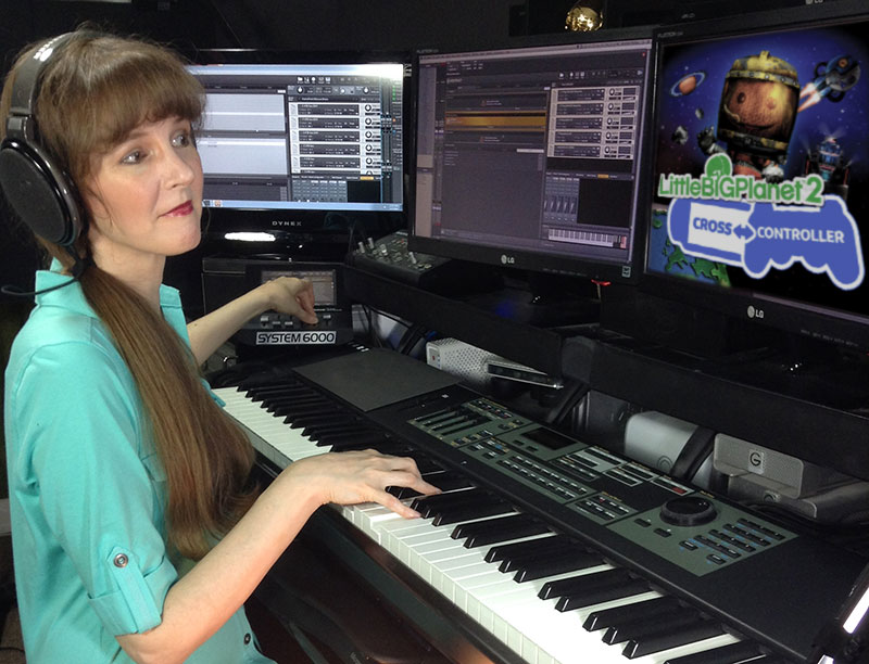 Video game composer Winifred Phillips, pictured in her music production studio working on the music of LittleBigPlanet 2 Cross Controller
