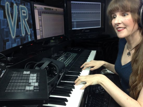 Video game music composer Winifred Phillips working in her game composers production studio.