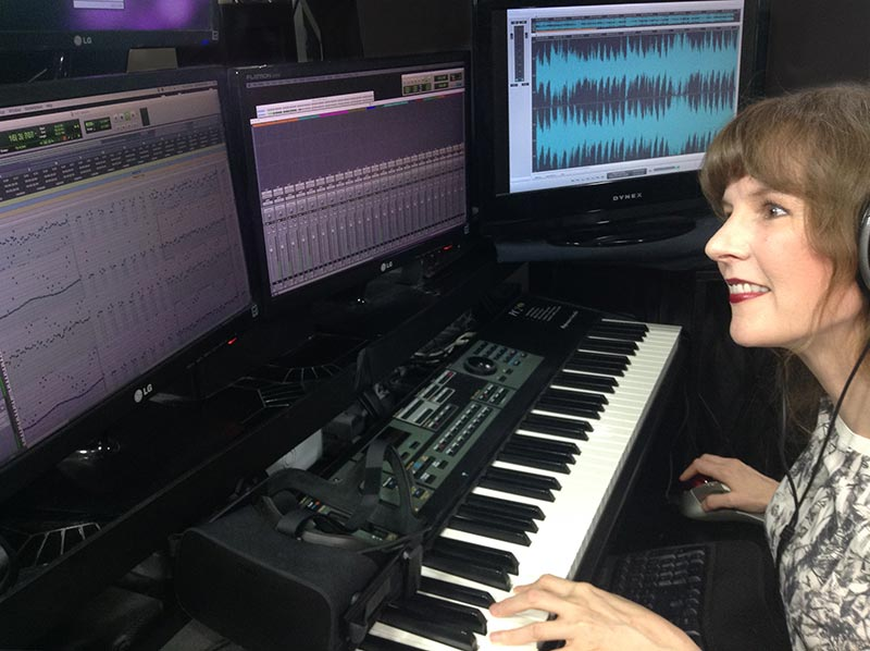 Video game music composer Winifred Phillips, at work in her music production studio.