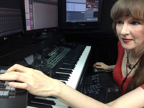 In this article for video game composers, Winifred Phillips is pictured working in her music production studio.