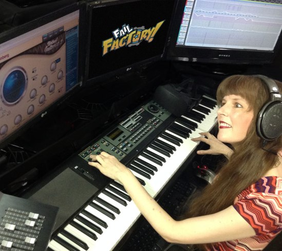 In this article series for video game composers, Winifred Phillips is depicted in this photo working in her music production studio.
