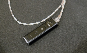 A photo of the SuperX-Fi dongle - in this article for video game composers, Winifred Phillips explores headphone tech appropriate for use in the popular Virtual Reality platform.