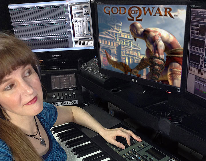 In this article written for video game composers, Winifred Phillips (composer of music for God of War) is here pictured working in her music production studio.