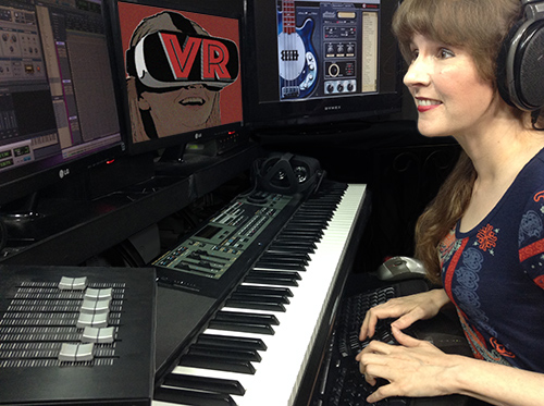 Video game music composer Winifred Phillips working in her video game music production studio, from the article discussing popular Virtual Reality arcades.