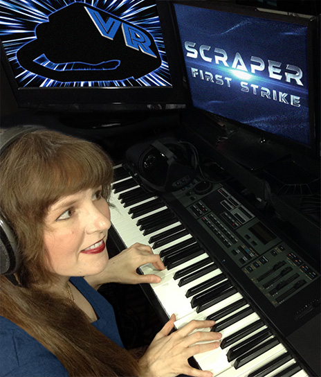 In this article written for video game composers, Winifred Phillips (video game composer) is here pictured working in her music production studio on the music for the Scraper: First Strike game, developed for popular VR gaming platforms (PSVR, Oculus Rift, HTC Vive).