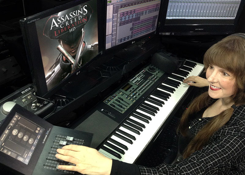 Video game music composer Winifred Phillips creating music in her video game music production studio.
