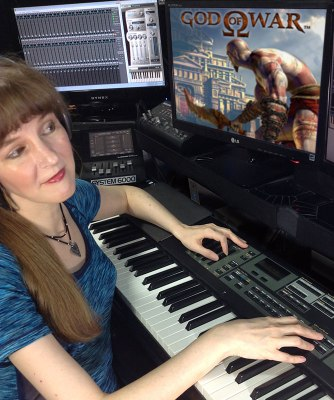 In this article for video game composers, popular game composer Winifred Phillips is depicted in this photo working in her music production studio.