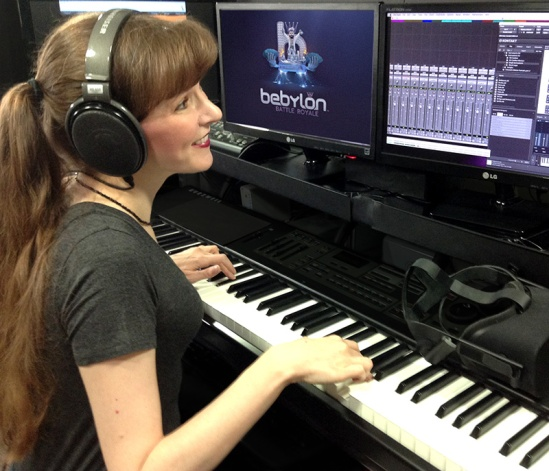 This photo shows video game composer Winifred Phillips working in her music production studio. Phillips has composed music for titles in five of the most popular franchises in gaming (Assassin's Creed, God of War, Total War, LittleBigPlanet, The Sims).