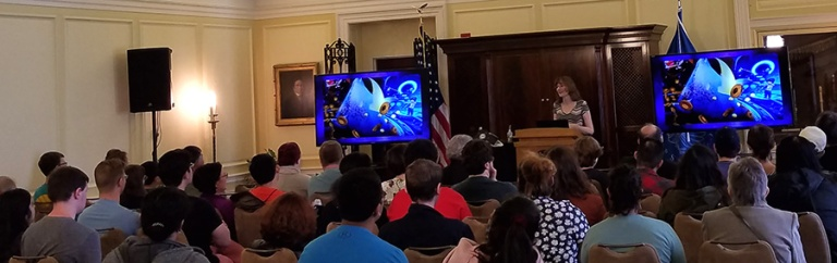 A photo showing Winifred Phillips (popular video game music composer) as she presents the first-ever video game music composition lecture to be given at the Library of Congress (Thomas Jefferson Building, Washington DC).