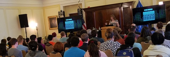 Popular video game music composer Winifred Phillips is pictured during her lecture at the Library of Congress (Whittall Pavilion, Thomas Jefferson Building, Washington DC). Presenting her lecture to a full-house at the Whittall Pavilion, Winifred Phillips gave the first video game music composition lecture at the Library of Congress.