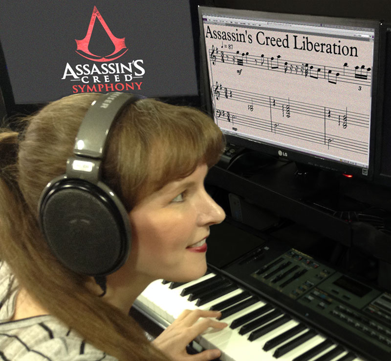 This photo shows video game composer Winifred Phillips working in her music production studio. Phillips has composed music for titles in five of the most popular franchises in gaming (Assassin's Creed, God of War, Total War, The Sims, LittleBigPlanet).