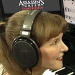 Popular game music composer Winifred Phillips works in her music production studio.