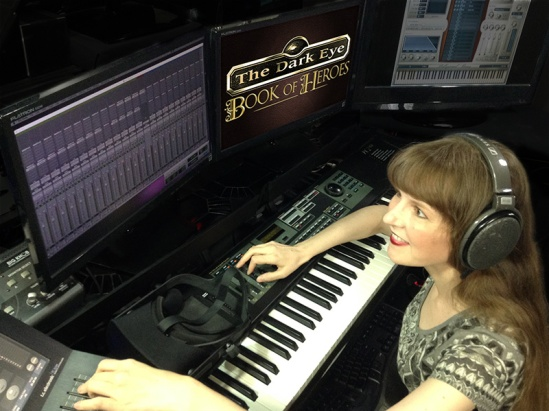 This photo shows video game composer Winifred Phillips working in her music production studio on music for the latest game in The Dark Eye franchise. Phillips has composed music for titles in five of the most popular franchises in gaming (Assassin's Creed, God of War, Total War, LittleBigPlanet, The Sims).