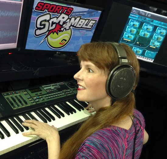 Working on the music of the VR game Sports Scramble, Winifred Phillips is here shown in her professional music production studio.